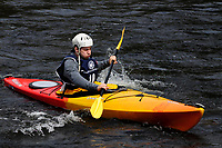 Kayaker in the Hudson River White Water Derby in North River, New York