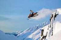 Jake Boulden snowmobiling in Chugach National Forest, Alaska.