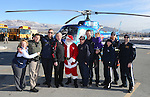 Event organizers pose for photos with Santa after he arrives on a Careflight helicopter at the 11th annual Holiday with a Hero at Walmart in Carson City, Nev., on Wednesday, Dec. 16, 2015. <br /> Photo by Cathleen Allison