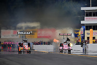 Oct. 1, 2011; Mohnton, PA, USA: NHRA top fuel dragster driver Spencer Massey (left) races alongside Terry McMillen during qualifying for the Auto Plus Nationals at Maple Grove Raceway. Mandatory Credit: Mark J. Rebilas-