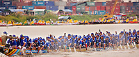 Dragon boat racing teams compete at the annual Water Festival, aka Bon Om Touk, in Phnom Penh, Cambodia. The festival takes place during the full moon in November at the confluence of the Mekong & Tonle Sap rives