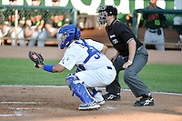 Julian Leon (34) of the Ogden Raptors behind the plate with home plate umpire Jordan Johnson during the game against the Great Falls Voyagers on July 16, 2014 at Lindquist Field in Ogden, Utah. (Stephen Smith/Four Seam Images)