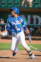 Michael Medina (25) of the Ogden Raptors at bat against the Grand Junction Rockies in Pioneer League action at Lindquist Field on July 5, 2015 in Ogden, Utah. Ogden defeated Grand Junction 12-2.  (Stephen Smith/Four Seam Images)