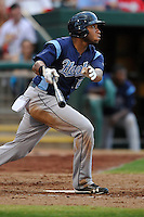 Jon Singleton (24) of the Corpus Christi Hooks drives a pitch to left field against the Springfield Cardinals at Hammons Field on August 19, 2012 in Springfield, Missouri.(Dennis Hubbard/Four Seam Images)