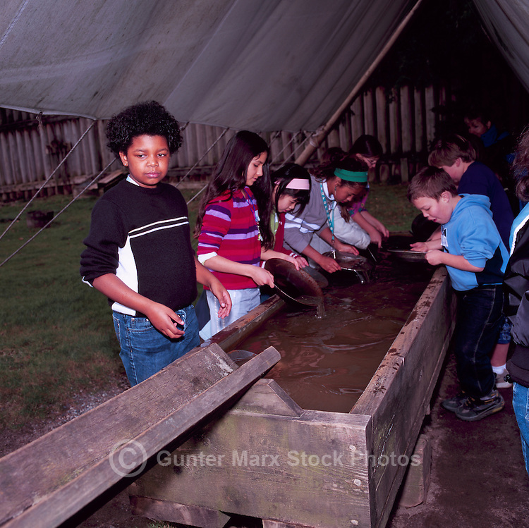 Fort Langley National Historic Site, BC, British Columbia, Canada - Children panning for Gold.  Fort Langley was founded in 1827 as a Hudson's Bay Company Trading Post.