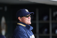 SAN FRANCISCO - JULY 20:  Manager Ned Yost of the Milwaukee Brewers gets ready in the dugout before the game against the San Francisco Giants at AT&T Park in San Francisco, California on July 20, 2008.  The Brewers defeated the Giants 7-4.  Photo by Brad Mangin