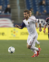 Real Salt Lake midfielder Kyle Beckerman (5) dribbles. In a Major League Soccer (MLS) match, Real Salt Lake (white)defeated the New England Revolution (blue), 2-1, at Gillette Stadium on May 8, 2013.