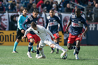 FOXBOROUGH, MA - MARCH 7: Alvaro Medran #10 of Chicago Fire captures the ball under the feet of Wilfried Zahibo #23 of New England Revolution during a game between Chicago Fire and New England Revolution at Gillette Stadium on March 7, 2020 in Foxborough, Massachusetts.