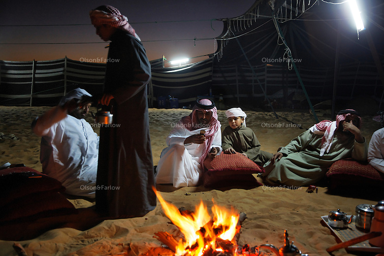 The Al Mansori family around the campfire at the Mansori family camel contest compound.  This family is from about 50KM outside Abu Dhabi.