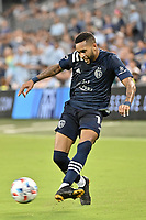 KANSAS CITY, KS - AUGUST 10: Amadou Dia #13 Sporting KC with the ball during a game between Club Leon and Sporting Kansas City at Children's Mercy Park on August 10, 2021 in Kansas City, Kansas.