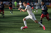 FOXBOROUGH, MA - MARCH 7: Robert Beric #27 of Chicago Fire pushes the ball towards the New England goal during a game between Chicago Fire and New England Revolution at Gillette Stadium on March 7, 2020 in Foxborough, Massachusetts.