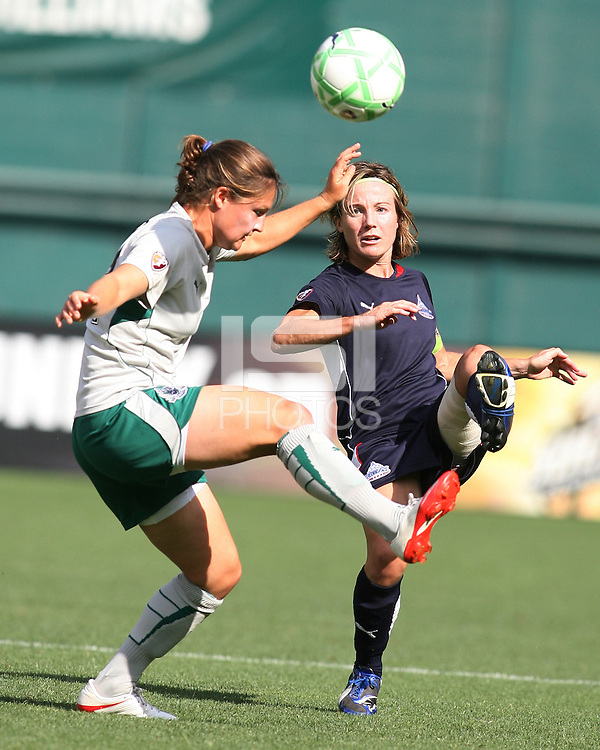 Sonia Bompastor #8 of the Washington Freedom boots the ball past Sarah Larsson #4  of St. Louis Athletica during a WPS match at RFK Stadium on July 18 2009, in Washington D.C.