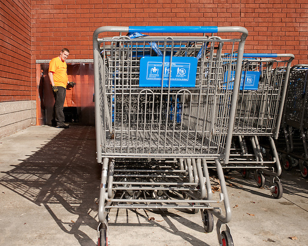 November 25, 2011. Durham, NC.. Joseph worked 15 hour shifts moving carts and helping customers during the Black Friday sales at WalMart..Black Friday sales at BestBuy and Walmart at New Hope Commons