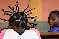 TOGO, Lome, girl with fancy hairstyle