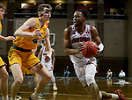 SIOUX FALLS, SD - MARCH 8: Stanley Umude #0 of the South Dakota Coyotes drives on Grant Nelson #4 of the North Dakota State Bison during the Summit League Basketball Tournament at the Sanford Pentagon in Sioux Falls, SD. (Photo by Dave Eggen/Inertia)