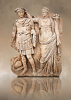 Photo of Roman releif sculpture of Aphrodite is crowned by Andreia from Aphrodisias, Turkey, Images of Roman art bas releifs. Buy as stock or photo art prints.  The drapped goddess figure is thought to be Aphrodite, whilst the female bare breasted warrior in amazonian dress is Roma or Andreia [ Bravery ].  Black
