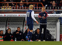 Brek Shea (l, USA) and Coach Juergen Klinsmann (USA), during the friendly match Italy against USA at the Stadium Luigi Ferraris at Genoa Italy on february the 29th, 2012.