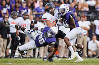 TCU safety Derrick Kindred (26) and safety Chris Hackett (1) breaks a pass intended for Oklahoma State wide receiver Austin Hays (17) during second half of an NCAA football game, Saturday, October 18, 2014 in Fort Worth, Tex. TCU defeated Oklahoma State 42-9. (Mo Khursheed/TFV Media via AP Images)