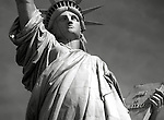 Black & white close up view of Statue of Liberty and her tablet on Liberty Island in New York City.