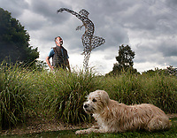 BNPS.co.uk (01202 558833)<br /> Pic: ZacharyCulpin/BNPS<br /> <br /> Sculptor Simon Gudgeon and his dog Luna. <br /> <br /> A picturesque sculpture park in the Dorset countryside has reopened to give people an outdoor escape away from the bustle of the packed beaches.<br /> <br /> Sculpture by the Lakes is a stunning beauty spot six miles from Dorchester and spans 26 acres, giving visitors plenty of room to enjoy the outdoors while remaining socially distanced.<br /> <br /> Owner Simon Gudgeon has more than 30 pieces of his work exhibited throughout the park and has installed two new sculptures for the reopening - 'Swallows' and 'Butterfly'.