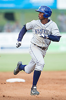Raimel Tapia (15) of the Asheville Tourists hustles towards third base after hitting a triple against the Kannapolis Intimidators at CMC-NorthEast Stadium on July 13, 2014 in Kannapolis, North Carolina.  The Tourists defeated the Intimidators 8-2.  (Brian Westerholt/Four Seam Images)