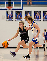 Claudia Bridges (1) of Fayetteville bring ball up the court as Camiran Brockhoff (3) of Rogers defending at King Arena, Rogers, AR January 8, 2021 / Special to NWA Democrat-Gazette/ David Beach