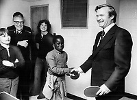 Ontario Premier William Davis shakes hands with Martin Thompson, 11, his partner at ping-pong in Regent Park yesterday. Davis took on all comers for five minutes. He was in Regent Park to see workshop where teenagers repair furniture given to them and sell it at low prices. He declined a chance to play snooker.