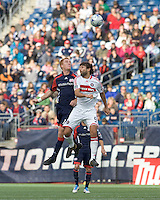 New England Revolution midfielder/defender Jeff Larentowicz (13) and Chicago Fire midfielder Baggio Husidic (9) battle for head ball. The New England Revolution out scored the Chicago Fire, 2-1, in Game 1 of the Eastern Conference Semifinal Series at Gillette Stadium on November 1, 2009.