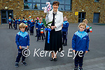 Students Timmy Sheehan and Tara Whelan presenting flowers to Norma Foley TD Minister of Education at O'Brennan NS on Wednesday.