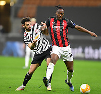 18th March 2021; San Siro stadium, Milan, Italy;  AC Milans Soualiho Meite heolds off Manchester Uniteds Bruno Fernandes during the Europa League round of 16 second leg match between AC Milan and Manchester United in Milan, Italy
