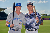 Dunedin Blue Jays Kacy Clemens (21) and Lakeland Flying Tigers Kody Clemens (8) pose for a photo before a Florida State League game on May 18, 2019 at Publix Field at Joker Marchant Stadium in Lakeland, Florida.  Dunedin defeated Lakeland 3-2 in eleven innings.  (Mike Janes/Four Seam Images)
