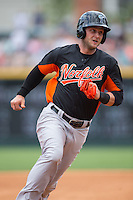 Christian Walker (22) of the Norfolk Tides rounds third base during the game against the Charlotte Knights at BB&T BallPark on June 7, 2015 in Charlotte, North Carolina.  The Tides defeated the Knights 4-1.  (Brian Westerholt/Four Seam Images)