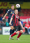 Ross County v St Johnstone...10.08.14  SPFL<br /> Scott Brown and Melvin De Leeuw<br /> Picture by Graeme Hart.<br /> Copyright Perthshire Picture Agency<br /> Tel: 01738 623350  Mobile: 07990 594431