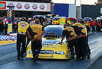 Jul. 26, 2013; Sonoma, CA, USA: NHRA Safety Safari members help crew members push funny car driver Jeff Arend back to the starting line after failing to get the car into reverse during qualifying for the Sonoma Nationals at Sonoma Raceway. Mandatory Credit: Mark J. Rebilas-