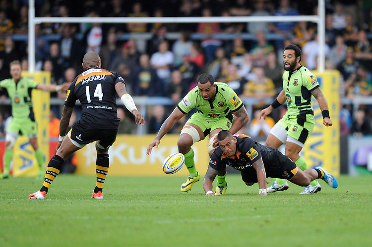 Samu Manoa of Northampton Saints and Nathan Hughes of Wasps scramble for the ball during the Premiership Rugby Round 2 match between Wasps and Northampton Saints at Adams Park on Sunday 14th September 2014 (Photo by Rob Munro)