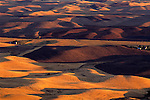 Rolling hills of croplands and wheat fileds at sunset from Steptoe Butte Eastern Washington State USA.