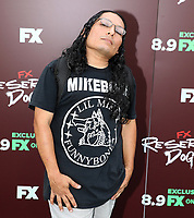 """TULSA, OK - AUGUST 2: Lil Mike attends the Red Carpet Event for the Series Premiere of FX's """"Reservation Dogs"""" at Circle Cinema on August 2, 2021 in Tulsa, Oklahoma. (Photo by Tom Gilbert/FX/PictureGroup)"""