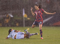 EAST HARTFORD, CT - JULY 1: Karina Rodiguez #3 of Mexico tackles the ball away from Christen Press #11 of the USWNT during a game between Mexico and USWNT at Rentschler Field on July 1, 2021 in East Hartford, Connecticut.