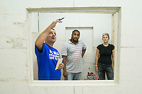 Instructor with students doing a course in tiling.  Able Skills in Dartford, Kent, runs courses in construction industry skills like, bricklaying, carpentry and tiling.