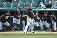 Kannapolis Intimidators manager Ryan Newman (5) coaches third base during the game against the Greensboro Grasshoppers at Kannapolis Intimidators Stadium on July 9, 2019 in Kannapolis, North Carolina. The Grasshoppers defeated the Intimidators 5-4. (Brian Westerholt/Four Seam Images)