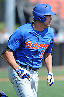 Florida Gators designated hitter Brian Johnson #35 runs to first after hitting  homerun during a game against the Tennessee Volunteers at Lindsey Nelson Stadium, Knoxville, Tennessee April 14, 2012. The Volunteers won the game 5-4  (Tony Farlow/Four Seam Images)..