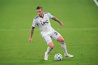 WASHINGTON, DC - AUGUST 25: Alexander Buttner #28 of New England Revolution moves the ball during a game between New England Revolution and D.C. United at Audi Field on August 25, 2020 in Washington, DC.