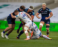 21st August 2020; AJ Bell Stadium, Salford, Lancashire, England; English Premiership Rugby, Sale Sharks versus Exeter Chiefs;  Jono Ross (C) of Sale Sharks (headband) is tackled by  Dave Ewers and  Sam Simmonds of Exeter Chiefs