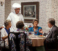 Chef visits with a group of seniors in an assisted living facility.