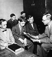 Sunday school teacher with class of boys.