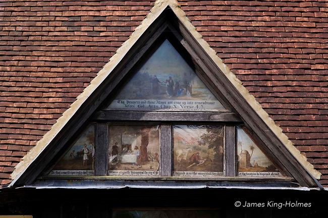 Painted panel above the doorway of the Long Alley Almshouses in Abingdon, Oxfordshire, UK, parts of which were built in the 15th & 16th centuries. Above the door the triangular panel has biblical scenes and miniatures of Edward V1 and Sir john Mason and is believed to be painted by Sampson Strong (1550-1611).They dwellings were founded by the medieval Fraternity of the Holy Cross which started the building work in 1446/47 and are now administered by the Christ's Hospital charity, founded in 1553.