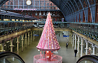 The Christmas 'Tree of Hope' stands in the centre of the ground floor of the concourse.<br /> St. Pancras International Rail station - in partnership with Elan Cafe - have unveiled this year's St. Pancras Christmas tree, titled 'The Tree of Hope'. It's located in the concourse at the international station in London. <br /> The 34ft carousel-themed tree is decorated with ribbons, featuring messages of love and hope from NHS staff and key workers who have worked throughout the COVID-19. London on Thursday November 12th 2020<br /> <br /> Photo by Keith Mayhew