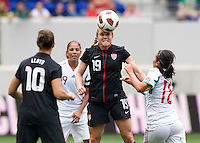 Rachel Buehler (19) of the USWNT  heads the ball past Veronica Perez (18) of Mexico during the game at Red Bull Arena in Harrison, NJ.  The USWNT defeated Mexico, 1-0.