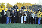 Jan.21, 2013 - Hot Springs, Arkansas, U.S -   Jon Court poses with owner Willis D. Horton, family and friends after he rode Will Take Charge, trained by D. Wayne Lukas, to victory in the 6th running of the Smarty Jones Stakes Saturday afternoon at Oaklawn Park.  (Credit Image: © Jimmy Jones/Eclipse/ZUMAPRESS.com)