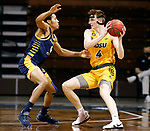 SIOUX FALLS, SD - MARCH 7: Grant Nelson #4 of the North Dakota State Bison looks for help while being guarded by Jacob Johnson #4 of the UMKC Kangaroos during the Summit League Basketball Tournament at the Sanford Pentagon in Sioux Falls, SD. (Photo by Richard Carlson/Inertia)
